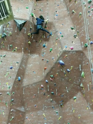 Rock climbing provides both a rush and a workout.