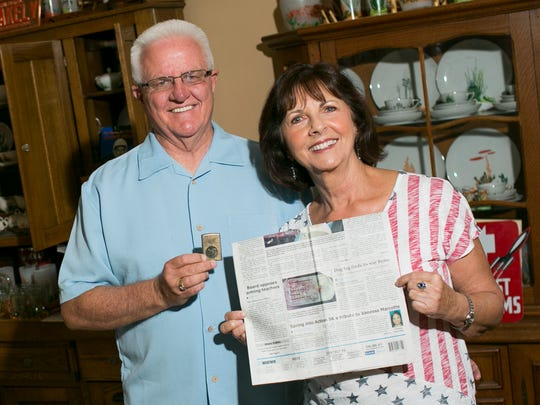 Randy Debes holds a Zippo lighter and Linda Gayles