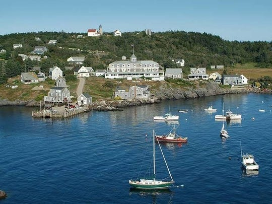 Nestled on a bluff overlooking Monhegan Harbor in Maine, the Island Inn is a handsome turn-of-the-20th century cedar shingled building.
