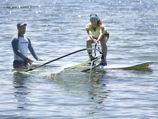 Reporter/columnist Victoria Freile gets pointers from windsurfer Doug Willard.