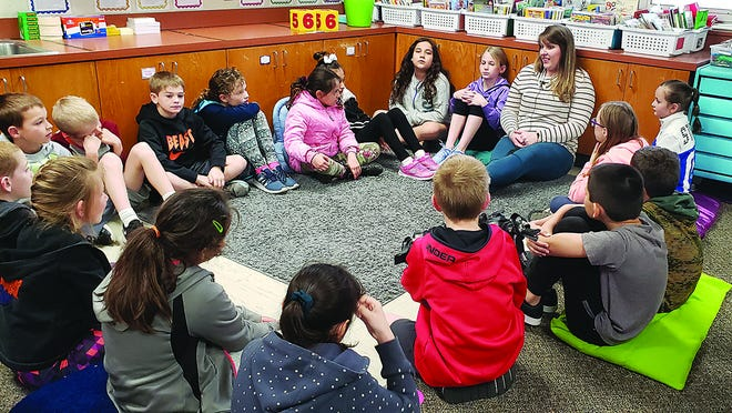 Pratt students and teachers, like Michelle Haskin (teacher seated) and her third-graders, will get an extra week of spring break before a determination is made on how USD 382 will handle spring semester classes, due to coronavirus concerns. [
