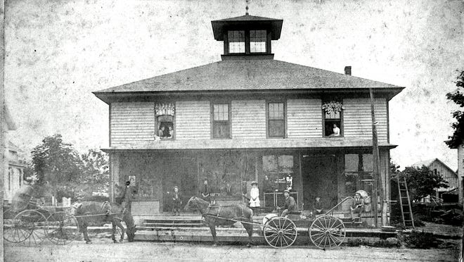 This circa 1885 photo, from the William V. Newcomb collection in the historian's office, shows Melvin B. Stevens, in the wagon, then the proprietor of the hardware store on South Avenue in Hilton. On the porch is his daughter Fern, and in a window above the store is his wife, Mary Archer Stevens.