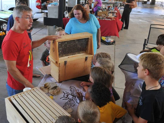 Randy Young (left) of Bees ARia talked to a small crowd