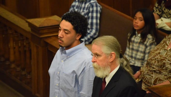 Daylon Waldrop, left, stands with his attorney, Thomas Fortner, as Judge Bob Helfrich reads the verdict in his capital murder trial. It took the jury 89 minutes to find him guilty.