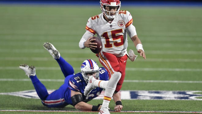 Kansas City Chiefs quarterback Patrick Mahomes (15) evades Buffalo Bills' Justin Zimmer during the second half Monday in Orchard Park, N.Y.