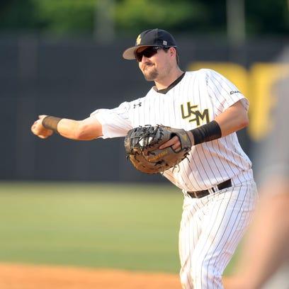 Southern Miss first-baseman Tim Lynch throws the ball