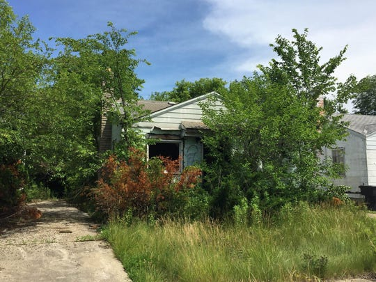 This house on Bloom is listed for just $500, but the buyer will owe over $2,000 in back taxes and fees.