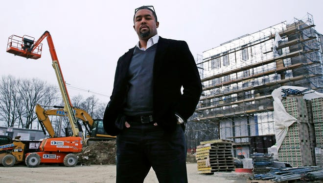 Architect Jonathan Garland poses for a photo on the construction site of a building he helped design in the Mattapan neighborhood of Boston on Tuesday, March 27, 2018. Garland's fascination with architecture started early: He spent much of his childhood designing Lego houses and gazing at Boston buildings on rides with his father away from their largely-minority neighborhood. As a teenager, Garland took drafting classes at a vocational high school, then attended Boston Architectural College, but he didn't see many who looked like him _ there were few black faces in classroom seats, and fewer teaching skills or giving lectures.