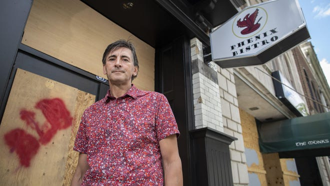 Cafe Phenix Bistro owner Gary McConnell stands outside the site of his now-closed cafe on Gay Street Downtown on Wednesday, June 24, 2020.