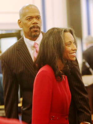 Tracie Hunter with attorney Clyde Bennett II during her October trial./The Enquirer