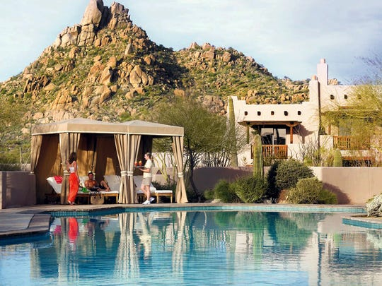 The pool and cabanas at the Four Seasons Resort Scottsdale