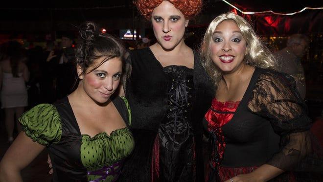 Grace Hymer of Bridgeton, N.J., Lisa Perks of Claymont and Kathy Torres of Newark on the Halloween Loop at Firestone in Wilmington on October 31, 2014.