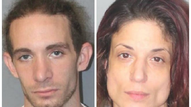 John Richard Tamulevich, 28, left, and Melissa Lee McPartland, 39, were arrested in Brockton on drug charges following a drug raid, Wednesday, Aug. 12, 2020.