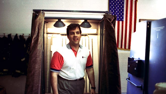 FILE PHOTO--Mendham, June 7, 1994-- Freeholder candidate Chris Christie walks out of the voting booth after casting his vote.