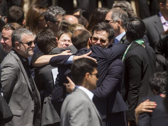 Mourners leave a memorial service for SurveyMonkey