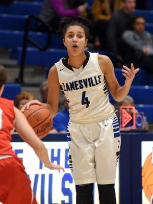 Zanesville point guard Destiny Johnson offers instruction to her teammates during the second half of the Lady Devils' 50-28 win against Sheridan on Monday at Winland Memorial Gymnasium.