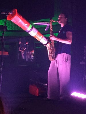 Moon Hooch often uses a traffic cone to magnify the sound of their saxophones.
