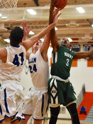Vying for a rebound Wednesday are Salem seniors Kyle Winfrey (41), Jeff Whalen (24) and Novi sophomore Jiovanni Miles (3).