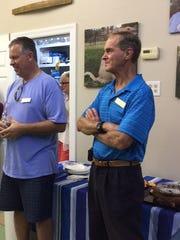 Board member John Pavela and board president Steve  Cargill enjoy the recent party at Caring Fields Felines.