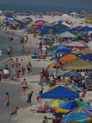 Casino Beach was already this full by 9:45 am Saturday morning with people waiting to see the Blue Angels Airshow grande finale, so crowds spilled over onto the west side of the pier for more viewing options.