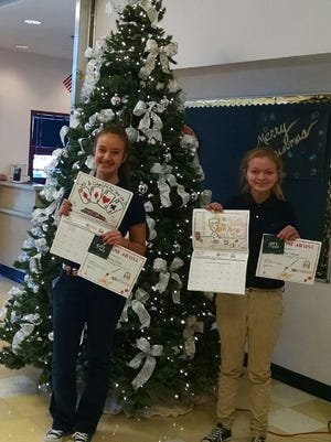 Ruidoso Middle School stuidents Ashley Flack and Sierra Tolhurst were awarded gift cards in a Mescalero anti-gambling poster contest.
