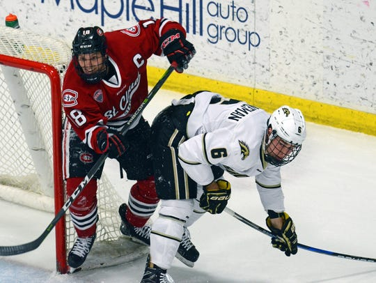 St. Cloud State forward Judd Peterson, 18, jostles