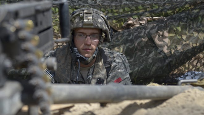 Tucked into a foxhole, Spc. Benjamin Kelly, a soldier with B Company, 186th Brigade Support Battalion of the Vermont Army National Guard, sits behind his M2 Browning while defending his troops' positions in the training area at Fort Polk, La., on June 17. The Vermont Guard is participating in a Decisive Action Training Exercise at the Joint Readiness Training Center.