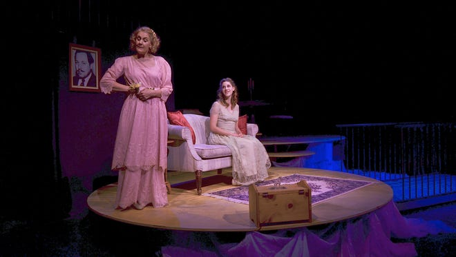 """Cathy Gabrieli, as Amanda Wingfield, and Katie Ghidossi, as Laura Wingfield, perform as mother and daughter in Tennessee Williams' """"The Glass Menagerie."""""""