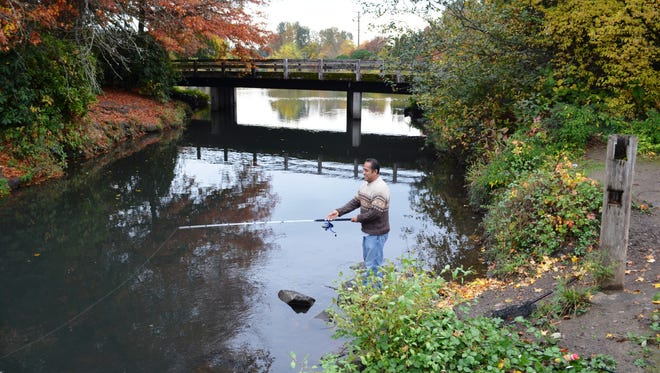 Fall is a great time to visit the Alton Baker Canoe Canal in Eugene, as Al Guisado, a retiree who has fished at the canoe canal for years can attest.