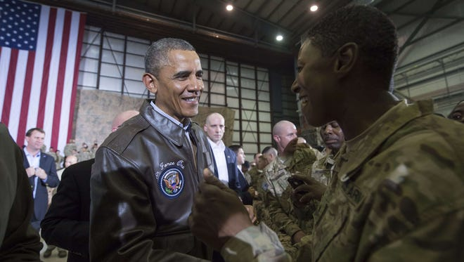 President Obama greets U.S. troops during a surprise visit to Afghanistan.