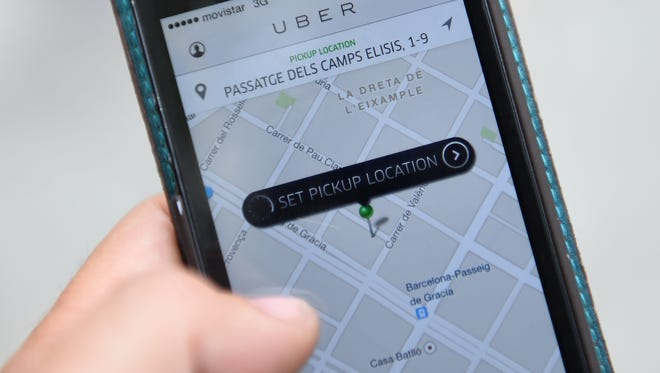 Uber customers use the company's smartphone app to schedule rides.