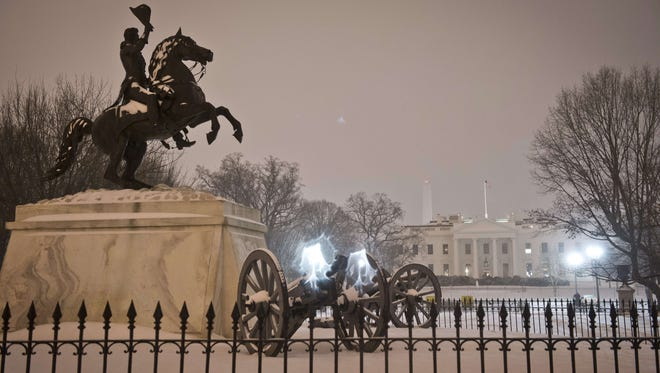 A view of the the cannons surrounding the statue of Andrew Jackson in Lafayette Square and of the White House as a heavy snow hits Washington, D.C.