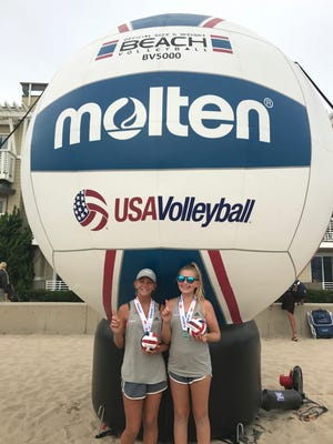 Lily Lucas of Naples, left, poses with partner Koko Hirsch of California after the two teamed up to win the USA Volleyball High Performance Beach Volleyball National Championship in Hermosa Beach, California, July 30-August 1. Lucas and Hirsch claimed victory in the U-13 division. The tournament brought together the top amateur beach volleyball players in the nation.