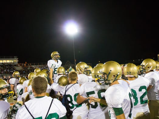 York Catholic celebrates following their 20-14 win
