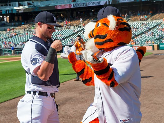 Tigers catcher James McCann pounds fist with Paws before