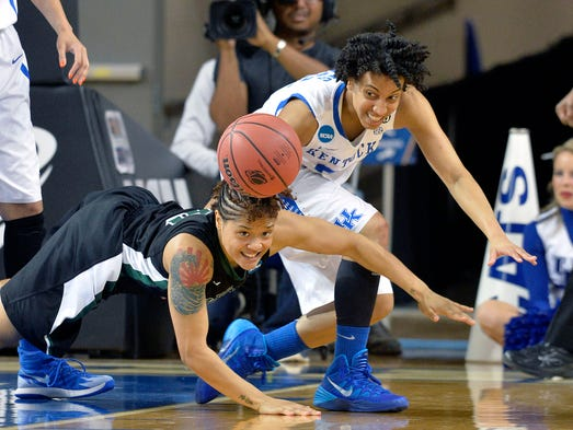 Wright State's Sarah Hunter, left, battles Kentucky's Kastine Evans for a loose ball during the first half of a first-round game in the NCAA women's college basketball tournament in Lexington, Ky., Saturday, March 22, 2014. (AP Photo/Timothy D. Easley)
