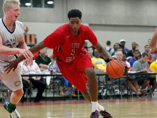 Raymond Spalding (5) battles pressure from Eric McCord (32) during their game at the AAU basketball Championship at the Fairgrounds in Louisville, Kentucky.       July 24, 2014
