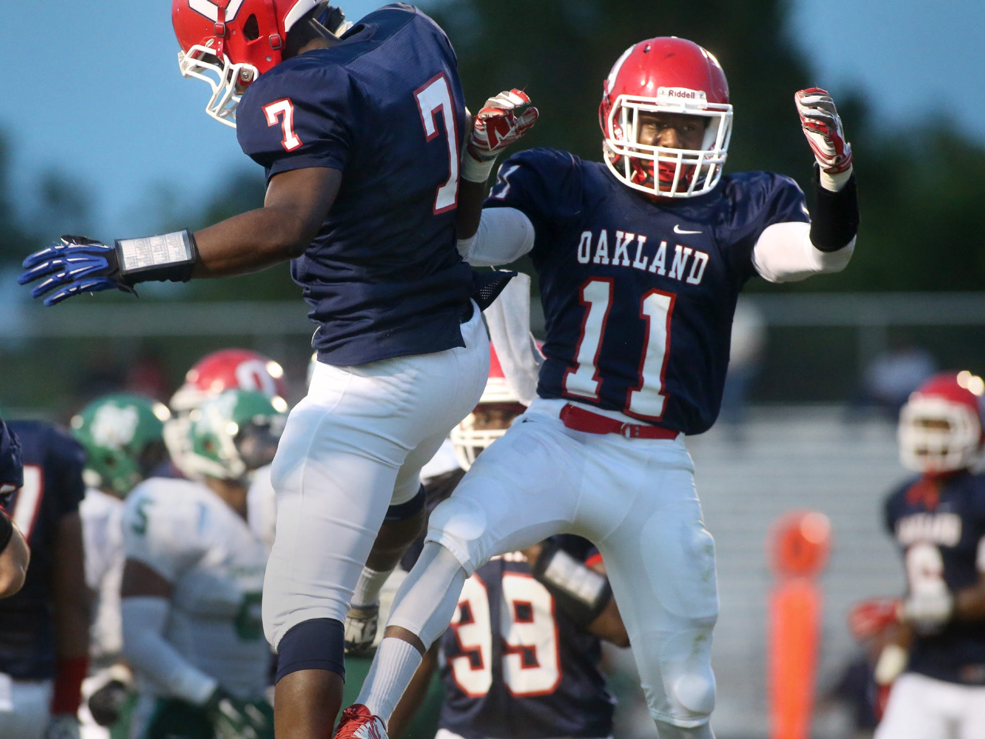 Oakland's JaCoby Stevens, left, and Josh Cunningham celebrate Cunningham's touchdown against White Station in the first half of the game at Oakland, on Friday, August 2, 2014.