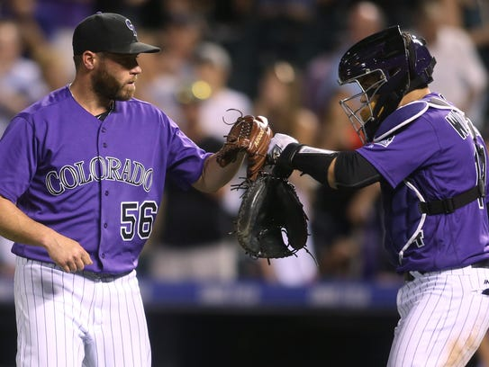 WNC native Greg Holland had a fist-pumping and fist-bumping