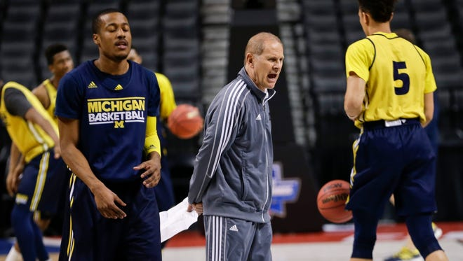 Michigan coach John Beilein calls out to his team during practice for a first-round NCAA tournament game against Notre Dame on Thursday in New York.