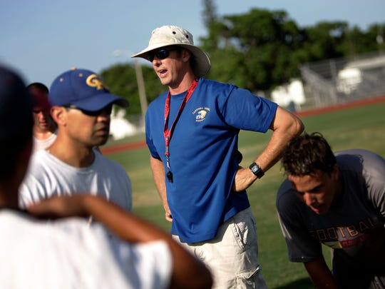 Steve Walsh, who spent time with multiple NFL teams, guides the West Palm Beach Cardinal Newman football team.