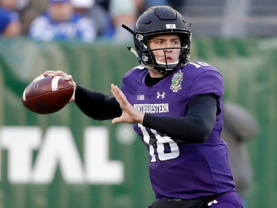 FILE - In this Dec. 29, 2017, file photo, Northwestern quarterback Clayton Thorson (18) throws a pass against Kentucky in the first half of the Music City Bowl NCAA college football game in Nashville, Tenn. Northwestern opens the college football season on Thursday, Aug. 30, 2018 against Purdue. (AP Photo/Mark Humphrey, File)