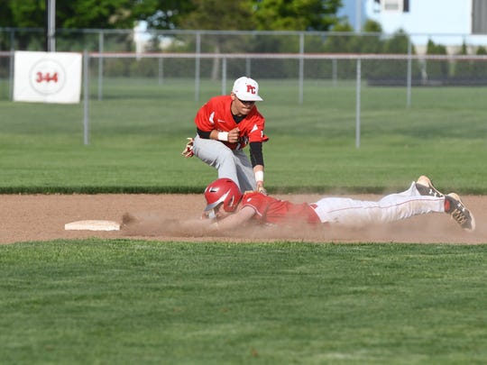 Port Clinton second baseman Braeden George tags out an SJCC baserunner Wednesday.