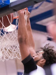 Tyler Collier, of Chambersburg, goes above the rim