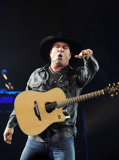 Garth Brooks is performing to a packed audience at the Allstate Arena in Chicago during his World Tour concert Sept. 4, 2014.
