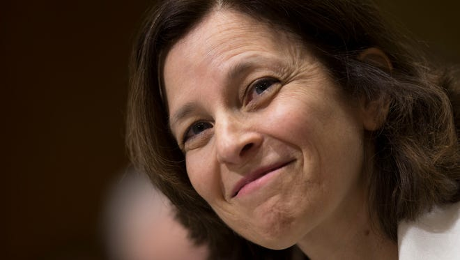 Sarah Bloom Raskin, governor of the U.S. Federal Reserve and nominee to be deputy U.S. Treasury secretary, smiles during a Senate Finance Committee confirmation hearing in Washington on Nov. 20.