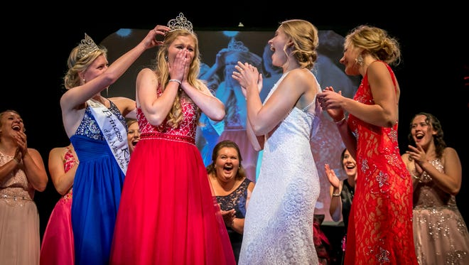 In this photo provided by Midwest Dairy Association, Emily Annexstad is crowned the 64th Princess Kay of the Milky Way during an evening ceremony at the Minnesota State Fairgrounds, Wednesday, Aug. 23, in Falcon Heights