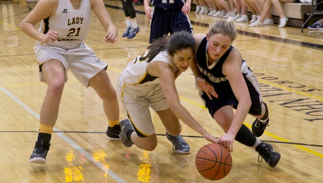 St John Vianney's Julia Ramos and Manasquan's Addie Masonius battle for a loose ball during first half action. Manasquan Girls Basketball vs St. John Vianney in Holmdel, NJ on February 2, 2016.