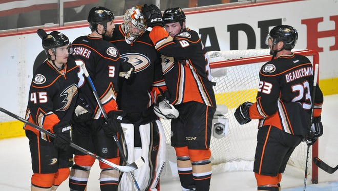 Anaheim Ducks goalie Frederik Andersen (31) is congratulated by defenseman Sami Vatanen (45), defenseman Clayton Stoner (3), left wing Matt Beleskey (39) and defenseman Francois Beauchemin (23) following the 6-1 victory against the Calgary Flames in game one of the second round of the 2015 Stanley Cup Playoffs at Honda Center.