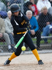 Waupun High School Softball's Erin Schmitt swings at a pitch against Winneconne in the second game of a doubleheader Tuesday, May 9, 2017. Waupun won both games 5-2 and 9-2.
